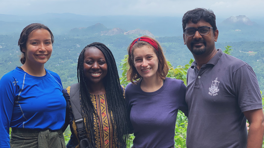 Students in Chennai, India in front of mountainous landscape