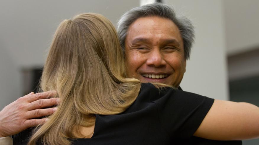 Joseph Galura hugging a student