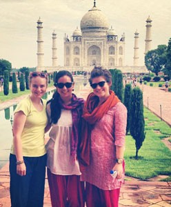 Global Independent Study student Ashley Bair with two fellow volunteers at the Taj Mahal in India